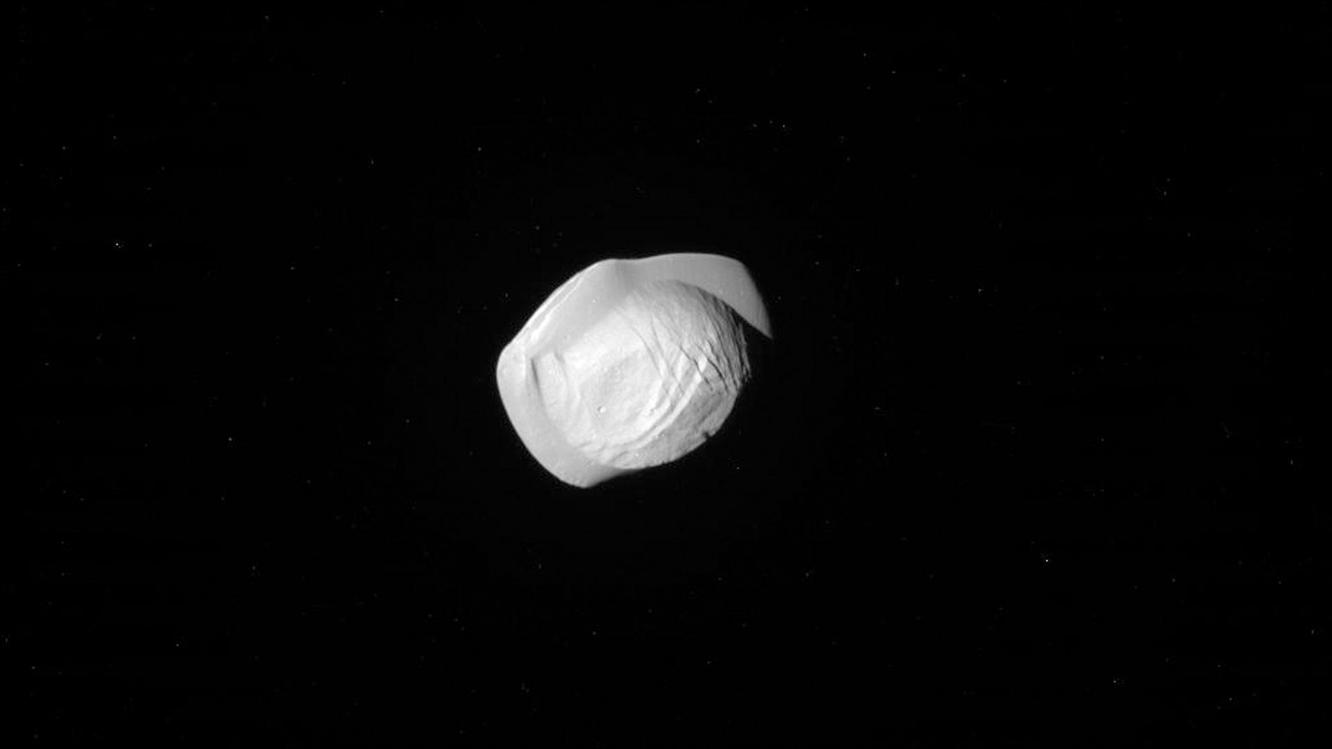 Saturn's tiny moon Pan looks like a space ravioli | khou.com