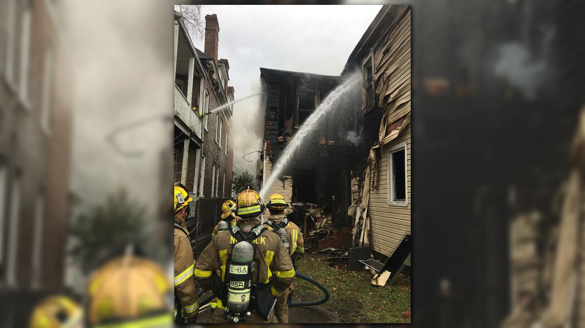 cloud of smoke rises as crews battle Norfolk house fire